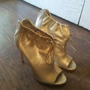 Gold zip-up heels